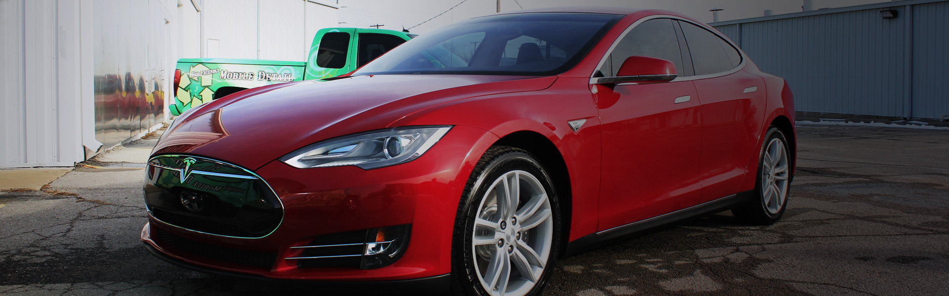 Picture of a Tesla Model S in EcoGreen's rotating banner