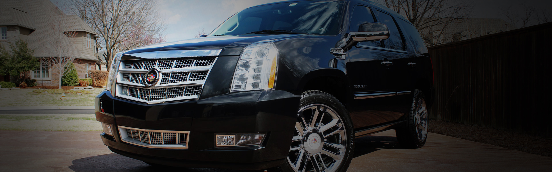 Picture of a Cadillac Escalade in EcoGreen's rotating banner